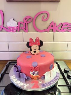 1 tier Minnie mouse and Daisy Duck cake. Double bow please