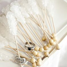 So cute! I am OBSESSED with wedding photography- and what an adorable way to show the rings- with rock candy ha!