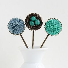 Oh my gosh!!! these are precious!! bird nest bobby pins :)
