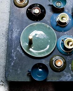 Styling: Cleo Scheulderman  Photo: Jeroen van der Spek  vtwonen #tableware #dish #candles #plate #cup # #green #blue #purple #tallow #DIY #turquoise #dark
