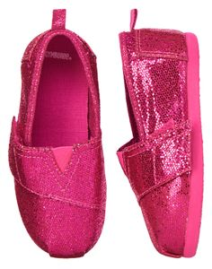 Girly to the max! Our comfy slip-ons are full of mega-watt shine in metallic pink canvas. Cushy thick sole and touch close strap make these as easy to wear as the are easy to admire.