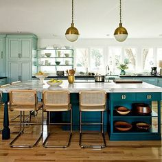 Furniture detailing gives the hardworking 5- x 7 1/2-foot island the look of a decorative buffet piece. The designers walled in an exterior door and shifted the eating area to the island to allow an impressive 285 cubic feet of cabinetry along the two walls. | SouthernLiving.com