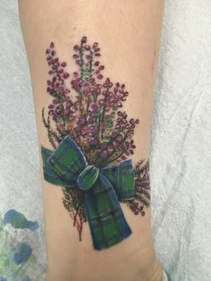 My new  Heather Tat to commemorate my trip to Scotland & Ireland. Done by Memo at Insight Studio, Chicago, IL. The ribbon is a family Tartan (Weir)