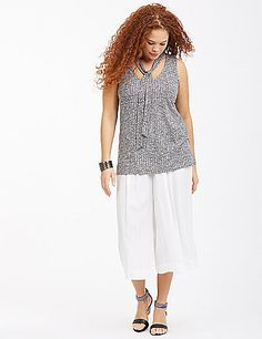 The ties give this wear-everywhere tank a little something extra. V-neck. lanebryant.com