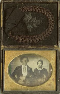 Victorian mourning momento, with a photo and a lock of hair.  These photos were sometimes taken postmortem, as many families had no other images of their loved ones.