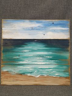 Beach Art seascape, Pallet beach painting, shabby beach, Ocean, reclaimed wood painting, Hand painted, upcycled pallet Dimensions are APPROX. 19 inches wide x 18 inches high A calming seascape with a sandy shore that appears to be a very old, weathered painting. It has been aged by sanding areas and the edges. The saying lifes a beach Chillax or just breathe can be added if you would like. It is painted on reclaimed fencing or pallet boards. This would be an interesting, personal touch to…