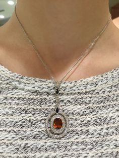 Multi-color topaz pendant in 14k white gold containing 1.24ctw diamonds and 2.58ctw topaz, 16'' long.