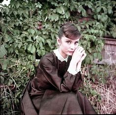 Audrey Hepburn photographed by Milton H. Greene on the set of War and Peace in Rome, Italy, 1955.