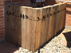 To hide the pool pump equipment we built a fence from pallets and painted on some birds.