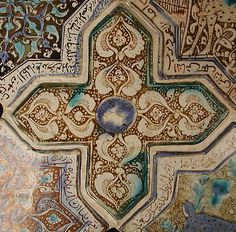 Cross-Shaped Tile  Object Name: Cross-shaped tile  Date: 13th century  Geography: Iran, probably Kashan  Culture: Islamic  Medium: Stonepaste; inglaze painted in blue and turquoise and luster-painted on opaque white glaze  Dimensions: 8 in. (20.3 cm) Wt. (whole group) 31 lbs. (14.1 kg)  Classification: Ceramics-Tiles  Credit Line: H.O. Havemeyer Collection, Gift of Horace Havemeyer, 1941  Accession Number: 41.165.37