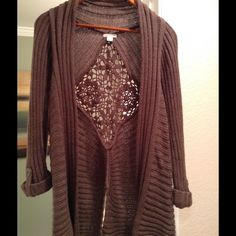 Fabulous fall cable sweater Brown, soft sweater with pretty open weave design on the back. The last picture shows the back with the design and split bottom. It's very flattering with leggings, boots and a top under. Always from a smoke free home. I fair offers Sweaters