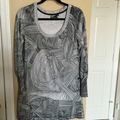 Volcom geometric sweater dress Size xl fits like true xl. Beautiful geometric print in black and white. Long enough to wear with tights. Volcom Sweaters