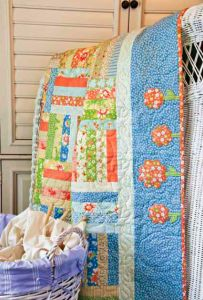 Summer!  I'm making this quilt.  After its machine quilted I will applique green vines and yoyo flowers around the border.