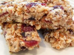 The BEST {and Most Dangerous} #paleo Granola Bars EVER!!1 3/4 cups almonds 3/4 cups sunflower seeds 2 Tablespoons chia seeds 1/2 cup dried blueberries 1/2 cup dried cranberries  1 cup unsweetened shredded coconut flakes 1/3 cup honey or syrup  1/2 cup coconut oil 1/2 teaspoon cinnamon pinch of salt Refrigerate