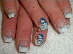 Frosty French Manicure with Snowman Accent Nails.