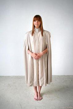 Grey raincoat by Nadija Kirpa. £189. Click on the image to view details/purchase! #RaincoatsForWomenGray