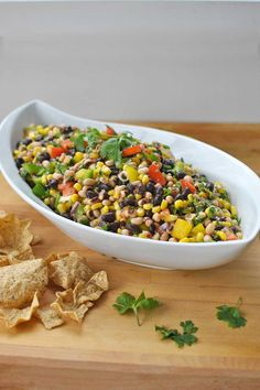 Put a Paqui Roasted Jalapeño Tortilla Chip in it! /// Cowboy Caviar Salsa is a healthful appetizer to add to a game day spread. Bright, colorful and full of nutrients, this dip be a winner no matter the outcome of the game. Easy, healthy and oh so tasty, this sunny dish will keep your spirits bright even if your favorite team isn't doing so hot by Becky's Best Bites