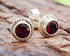 This listing is for pair of stud earrings Sterling Silver and Garnet Stone Stud Earrings ▶ by Einat ◀ Simple and elegant Stud Earrings. Perfect to wear on a daily basis. Garnet Qualities: ▶ Vitality ▶ Passion Earring diameter 0.6 cm For more stud earrings click her: #stonestudearrings
