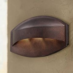 """Possini Euro Design Bronze Dark Sky 11"""" Wide LED Wall Sconce ~ Modern lines are combined with gorgeous materials in this horizontal LED outdoor light. The sleek design will add contemporary class and appeal to your home. This outdoor wall light features a bronze finish and is Dark Sky regulations compliant. It may also be used indoors as a wall sconce."""
