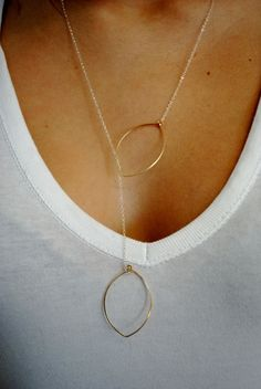 Bend an old pair of seldom worn hoop earrings and put on a chain to create a uniquely beautiful necklace.