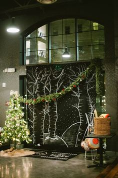 made the backdrop using a queen sheet and puffy paint! (chalkboard look...draped with Christmas garlands)