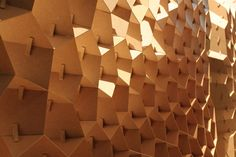 Five architecture students of the Institute for Lightweight Structures and Conceptual Design (ILEK) at the University of Stuttgart have created an exhibition stand with an irregular honeycomb MDF structure.