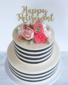 Black and white striped cake with flowers for a retirement party!