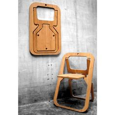 Desile Folding Chair - is less than an inch thick when closed. The chair when closed can hang on a wall providing a nice graphic interest to a space. It is available in natural bamboo or metal laminate.