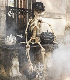 Every haunted house needs a skeleton hanging around at Halloween.   at Chasing-Fireflies.com