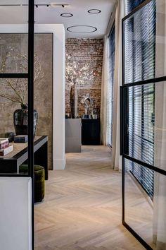 Love the door, floor and exposed brick. Atelier Laren - Kabaz