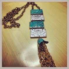 Antique brass tassel necklace with patina metal squares