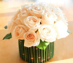 Bamboo container with roses. simple and refreshing. Arrangement was done by Bing Floral Design