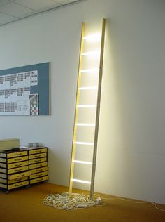 Title: Ladder Year: 2001 Materials: 15W fluorescent lights, wood, connectors, pre-starters, starters, electrical wire, plug Dimensions: L 100 cm W 100 cm H 330 cm