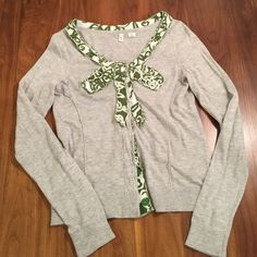 "Anthropologie MOTH Sweater Grey cotton/nylon blend cardigan. Trimmed in green/white bow appliqué. Hidden snap closure. 16"" across bust. 22"" length. Anthropologie Sweaters Cardigans"