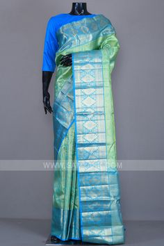 Keeping the desi fashionista in mind, this kanchipuram or kanjivaram silk saree features zari weaving all over the saree and is colored in green and gold dual tone. The saree is further enhanced with cerulean blue colored zari woven border and pallu. The saree comes along with a matching colored unsitched blouse fabric. There might be a little color variation in the image and original product due to photographic lighting sources or your monitor settings. Kanjivaram Sarees Silk, Saree Fashion, Saree Styles, Saris, Indian Sarees, Sarees Online, Green And Gold, Stuff To Buy, Color