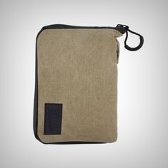 "The RYOT PackRatz in Tan is a compact protection solution for daily use. These well padded pouches feature a SmellSafe™ zipper and microscopic carbon application to create a scent resistant enclosure for your favorite glass, vaporizer, or other small valuables. •	Size: Medium •	Dimension: 4.5"" x 6.5"" Sizes"