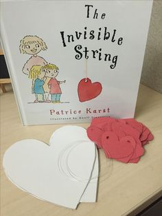 """Great book with activity to make a heart mobile of all those we are connected to through """"invisible strings"""""""