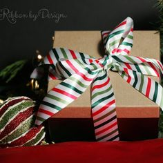 Christmas ribbon with stripe in lime, red and green comes in three sizes! Such a fun and whimsical design is perfect for everything from large packages to tiny boxes!