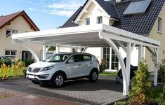 Carport in Fichte mit zwei Leimholzbögen, vom Kunden in weiß gestrichen Can get this one as a single car port with a 2 m storage room and a wall on one side for Plus painting. My favourite Carport Garage, Pergola Carport, Deck With Pergola, Patio Roof, Pergola Patio, Pergola Kits, Gazebo, Pergola Ideas, Carport Canopy