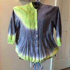 Desigual Tie Dye Crepe Embroidered Tunic NWOT Desigual Tie Dye Crepe Embroidered Tunic NWOT size Large but is roomy. Has gathered hem. Either wear it tied and blousy or let it hang loose. Super cute embroidered detail on back. Mother of pearl buttons from collar to hem. Price is FIRM unless bundled!! Desigual Tops
