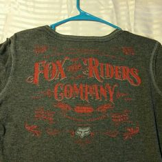 "Fox Racing shirt Super cute Fox long sleeve thermal shirt. Dark gray in color with red detailing on back (picture 1) and red embroidery ""ride on"" on left shoulder (picture 2)   No trades or pp Fox Tops"