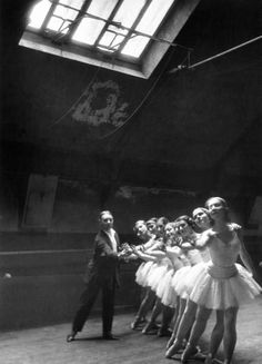 Ballet master with ballerinas practicing classic excercise in rehearsal room at Grand Opera de Paris.   by Alfred Eisenstaedt (c.1930)