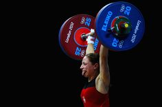 Aleksandra J Klejnowska-Krzywanska of Poland competing in the Women's 53kg Weightlifting    Photo by Laurence Griffiths/Getty Images