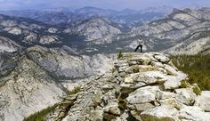 A hiker on the catwalk at Clouds Rest in Yosemite. Photo by Miguel Vieira