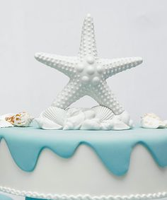 Starfish Cake Topper - Complement a beach themed wedding with this sophisticated starfish cake topper. Pure white with white shells at its base. White bisque finish.