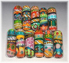 color and pattern overload! so great - Anne Ricketts. #lampwork #beads
