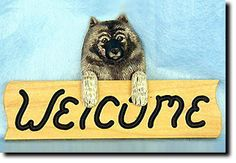 Keeshond - Dog Breed Welcome Sign - Our unique selection of hand painted natural oak Dog Breed Welcome Signs are sure to please the most discriminating Dog Lover! Be the envy of everyone with this uni...