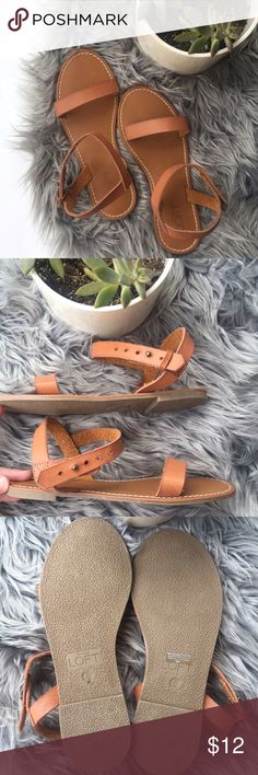 loft/ leather sandals Super simple, classic leather flat sandal. Brand new without tags. The only flaw is that the right shoe is missing the tiny leather piece to secure the end of the strap; shown in photo. LOFT Shoes Sandals