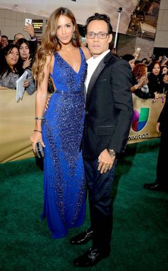Shannon De Lima & Marc Anthony at 2014 Latin Grammy Awards Red Carpet Arrivals These happy-in-love newlyweds know how to arrive in style! Shannon stuns in a beaded, cobalt-blue gown, while Marc wears a sleek black tuxedo.