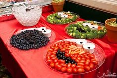 Fruit and veggie platters made using Sesame Street characters (Oscar, Cookie Monster, and Elmo).